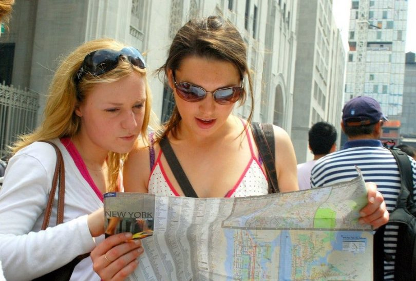 Two girls reading map