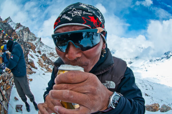 Sherpa drinking beer